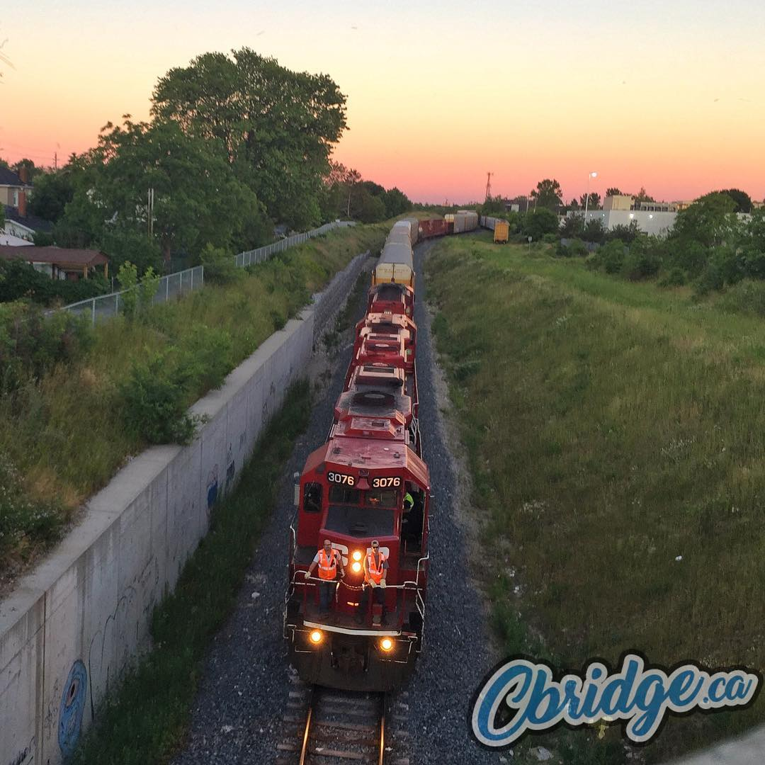 Watching from above on Hespeler Road #mycbridge #sunset #train #cprail